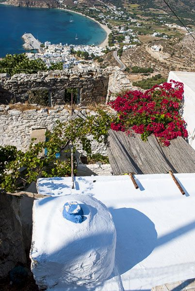 On the streets of Potamos with view to the bay of Aegialis - Amorgos island, Greece