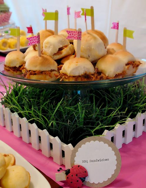 love the grass and cake stand!  Awesome idea--use the small picket fences I have with smaller display stands