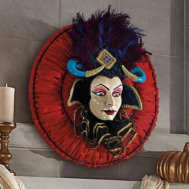 The Temptress Wreath.  I love this -- it so reminds me of the faces on a Mardi Gras float.  Must have for our Mardi Gras Voodoo Masquerade Halloween Party!