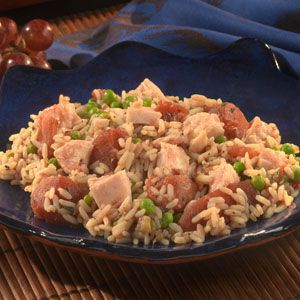 Grab your saucepan, some canned chicken, frozen peas, chicken stock and a few pantry ingredients, and in just about 40 minutes you'll have a kicked-up chicken and rice dinner that's both savory and satisfying.