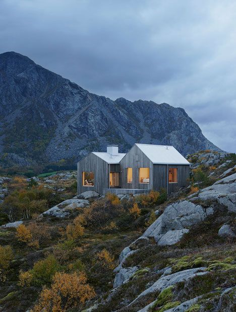 This solitary wooden cottage on the Norwegian island of Vega was designed by Swedish studio Kolman Boye Architects to resemble the weather-beaten boathouses that are dotted along the island's coastline (+ slideshow).