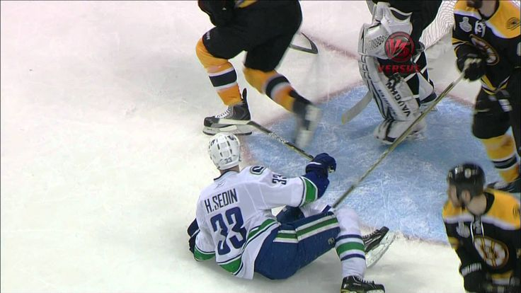 Tim Thomas levels Henrik Sedin in Game 3 of the Stanley Cup Finals, on June 6, 2011.