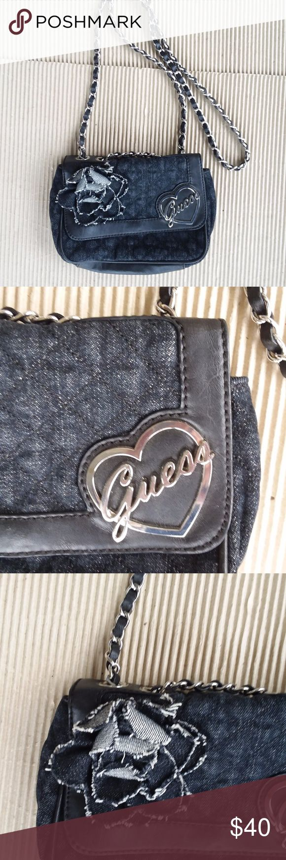 Vintage GUESS Handbag Black Jeans On Heart Gorgeous black jean handbag brand of GUESS. This handbag's name brand is GUESS on the heart and flower as see picture, and handbag will be great for fitting unisex. Good condition but please be making sure to see all photos. Guess Bags Clutches & Wristlets