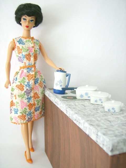 Retro housewife,(bubblecut Vintage Midge?)  Barbie ~ I totally have her upstairs in my closet.. I wish I had those dishes of hers too ... lol