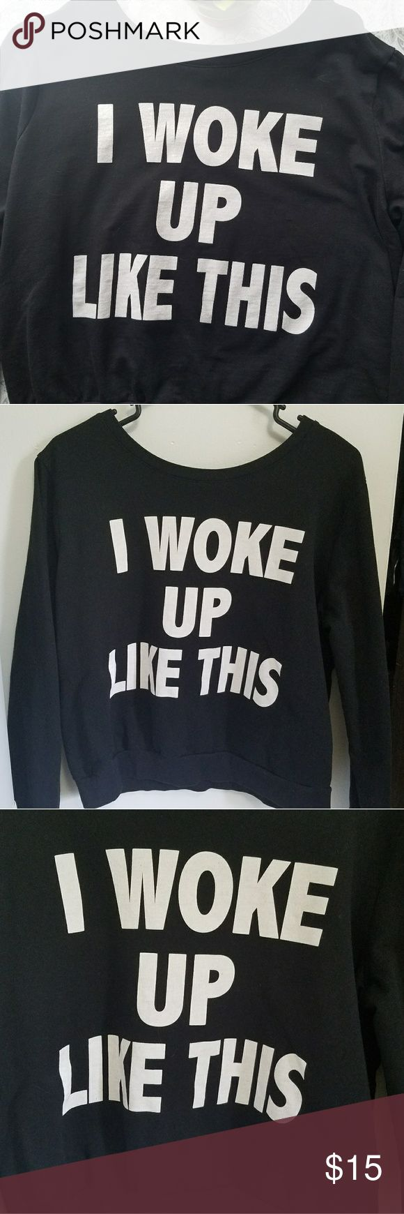 """""""I woke up like this"""" pullover sweatshirt This cotton """"I woke up like this"""" pullover sweatshirt is the perfect addition to any casual wardrobe.  Solid black with white writing, the sweatshirt measures 21 inches long and fits slightly oversized/baggy. none Sweaters Crew & Scoop Necks"""