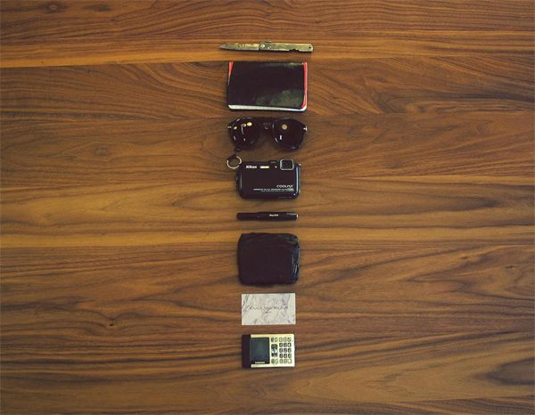 Calen Knauf  Calen Knauf makes up half of the Knauf and Brown studio based in Vancouver, Canada. The contents of his bag are kind of weird: a pocket camera, notebook, sunglasses, a handy pocket knife and an old cell phone.