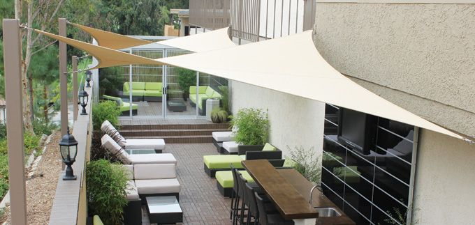 Cool outdoor space with shade sails for cover.
