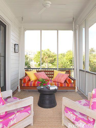 A screened porch in a Sullivan's Island, South Carolina, house is collaged in bright outdoor fabrics. Design: Sally Markham.