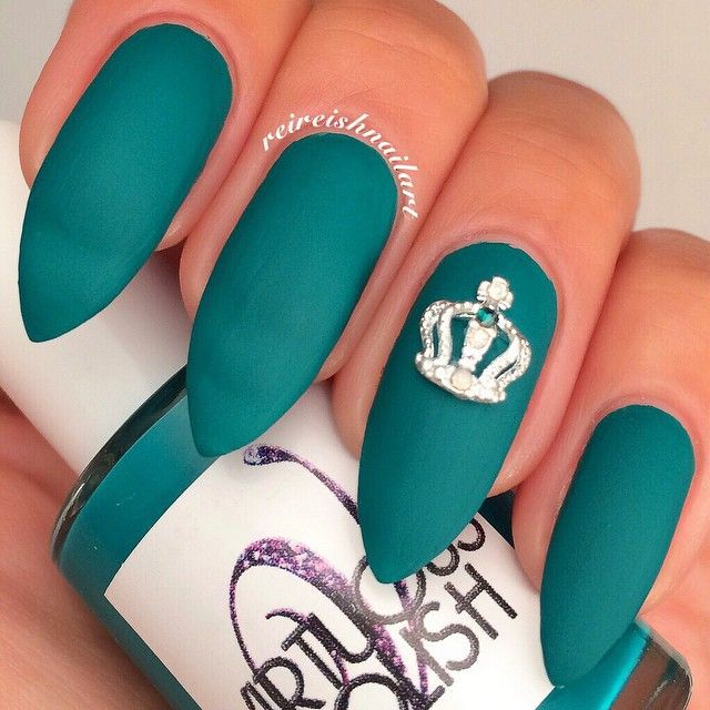 matte teal nails with crown charm