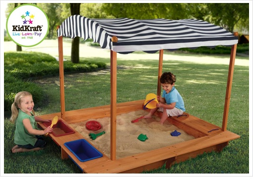 Playtime is fun time with the Outdoor Sandbox! Fashioned of reinforced wooden panels which help prevent damage from the weather and warping, this sandbox is designed to be sturdy and is large enough to allow several children to play at a time. The wooden sides provide seating and a mesh cover dutifully covers the box when it isn't in use. A beautiful striped canopy offers protection from the sun.
