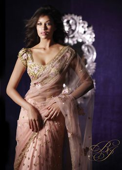 glamorous cream sari with light pink hues