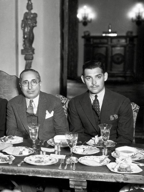 """Clark Gable and Louis B. Mayer attending an MGM dinner party, 1933 """