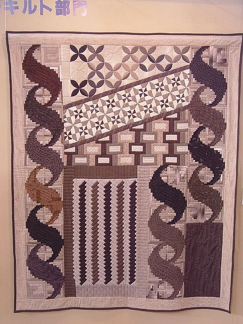 The 'S' curves made with log cabin blocks are fascinating.