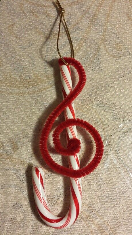 DIY Candy Cane Treble Clef Ornament Use hot glue to glue the pipe cleaner onto the candy cane.
