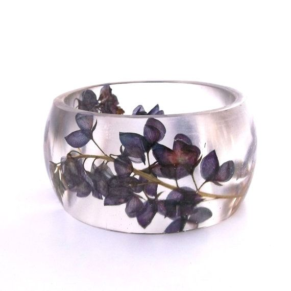 Size XL Botanical Resin Bangle.  Blue by SpottedDogAsheville, $49.00. Almost looks like little butterflies.
