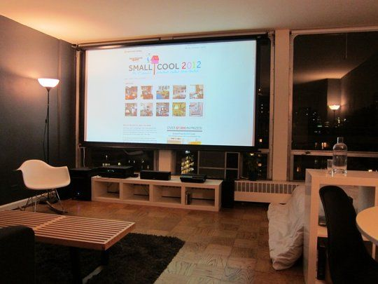 Entertainment system set up in front of living room windows using a