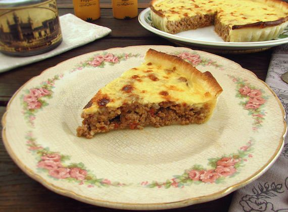 Meat pie | Food From Portugal. A delicious pie filled with minced meat spiced with pepper, salt, oregano, nutmeg and garlic, cooked in tomato, olive oil and onions, drizzled with a delicious sauce and sprinkled with grated cheese.  http://www.foodfromportugal.com/recipe/meat-pie/
