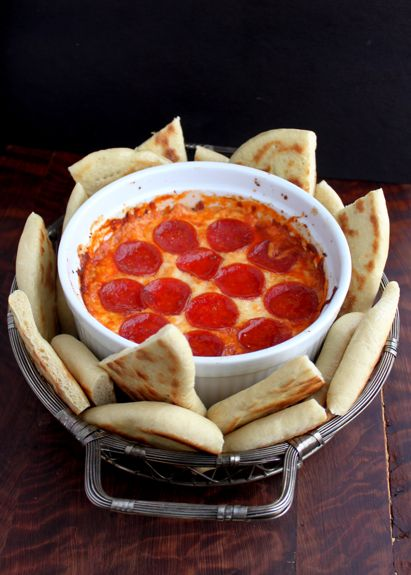 4-Layer Deep Dish Pizza Dip and Flatbread: Use your judgment on amounts based on your baking pan.  You want about an inch total of all layers.  Layer ricotta, top with shredded italian cheese, top with pizza sauce, top with chopped up pepperoni.  Bake at 350 for 30 minutes.  Serve with flatbread wedges for dipping.  Or maybe thinly sliced baguette.
