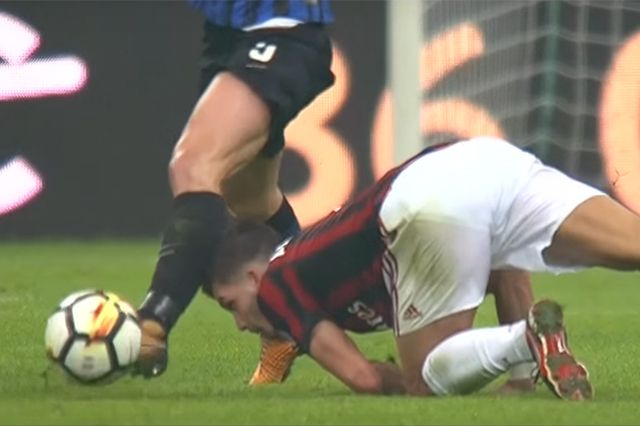 AC Milan striker André Silva tackles Inter Milan player Roberto Gagliardini with his head