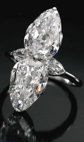 Cartier Diamond Ring, circa 1930s, set with two pear-shaped diamonds weighing 2.31 and 2.34 carats respectively, further accented with two marquise-shaped diamonds, signed Cartier London, case stamped Cartier Paris. (=)