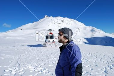 Man looking away with helicopter in background Royalty Free Stock Photo