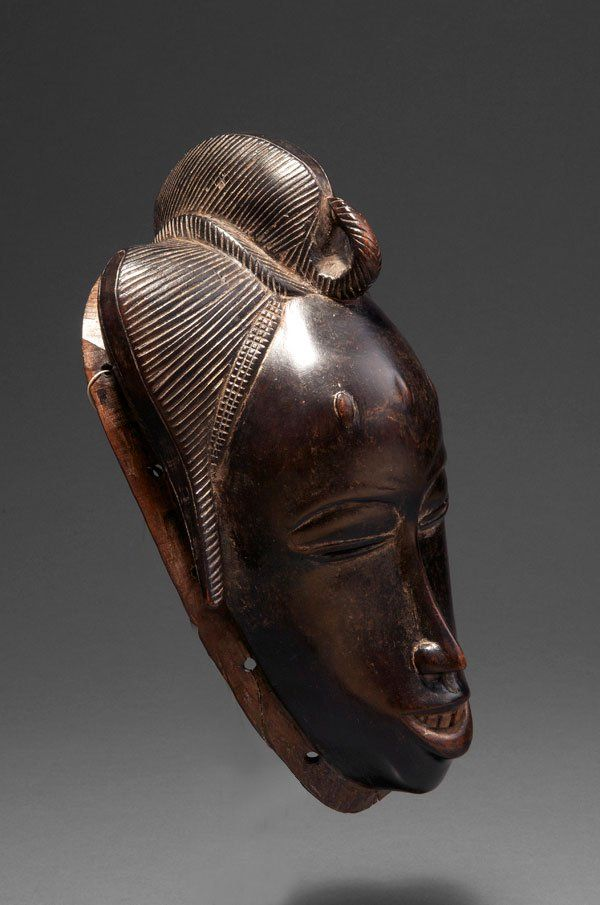 Ivory coast, Guro. A female mask with fine incised coiffure.