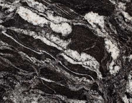 Silver Waves Granite from Pokarna is a amazing dark and greyish tough slab granite accessible in both sharpened and polished surface finishes.  Applications:  • Flooring • Cladding • Counter Top