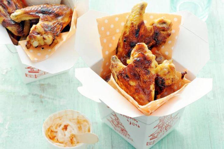 Chicken wings zijn niet voor niets altijd als allereerste op: kids smullen ervan, en volwassen óók! - Recept - Allerhande