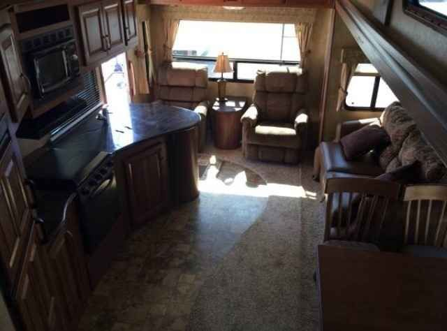 """2012 Used Forest River Wildcat Fifth Wheel in Texas TX.Recreational Vehicle, rv, 2012 Forest River Wildcat , Wildcat Sterling Edition 30RL WELL BELOW NADA VALUE NEED TO SELL SOON!! 15K BTU Ducted Roof Air Conditioner 15K BTU Ducted 2nd Air Conditioner- Bedroom Level Up 6-Point Hydraulic Auto Level System (In Place Of Rear Electric Jacks) 32"""" Jensen Flat Panel HDTV with HDMI Hook-up Corian Solid Surface Countertop (Kitchen) with Upgraded Pull-out Sprayer Faucet Electric Fireplace La-Z-Boy…"""