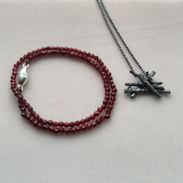 January's birthstone is Ggarnet. We paired this magnetic clasp garnet bracelet with with our oxidized-silver Slashpile necklace! 