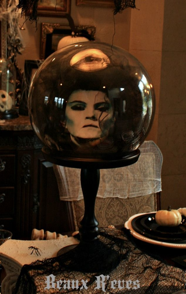 Madame Leota (fishbowl, black tulle and a print out of her face) Beaux R'eves: The Haunted Dining Room How-To's