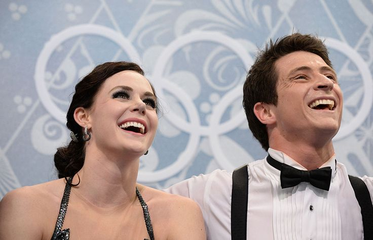 """Canada's Scott Moir and Tessa Virtue wait for their marks in the """"kiss and cry"""" after ice dance short"""