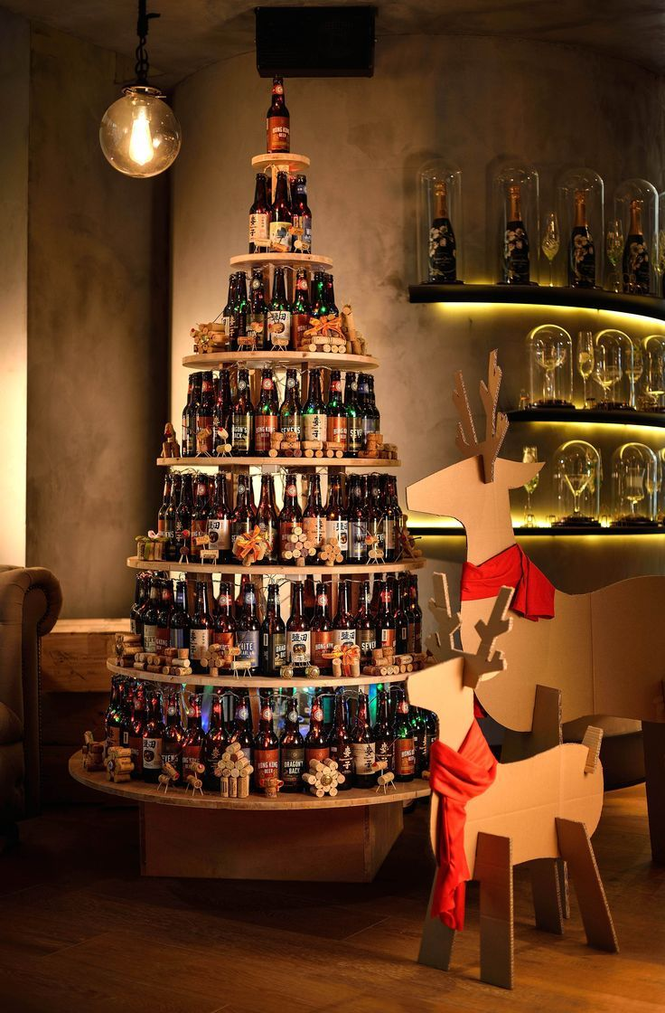 Cordis, Hong Kong's Sustainable Christmas Tree was created by stacking 170 used local Hong Kong Beer bottles with Christmas ornaments decorated with the use of upcycled wine corks and tree twigs. Reused cardboard was also cut to mimic life size festive Reindeers while recycled clothes were used to accessorize the Reindeer display.