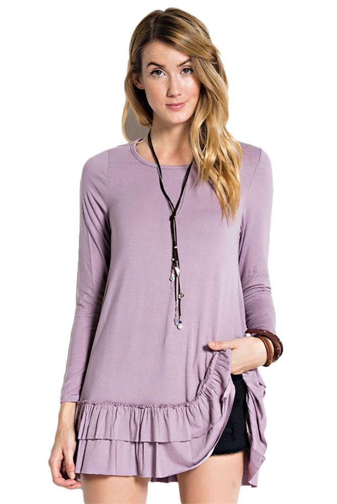 Long sleeve round neck soft heavy rayon span ruffle tunic, can be worn  under a top as a layered look.