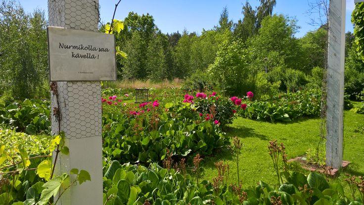 Walking on the lawn is ok! Botania, the tropical butterfly garden in Joensuu, Finland.