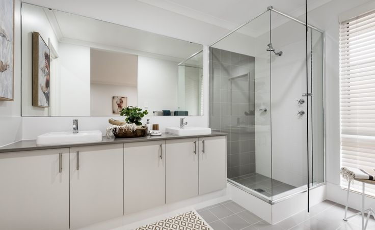 The ensuite features double semi-inset basins, Caesarstone benchtops and flick mixer taps