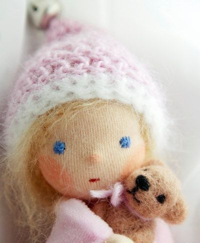 Just a picture, but what a beautiful angel of a doll!  I love her little teddy bear.