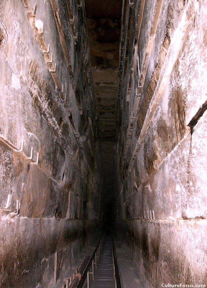 The Grand Gallery inside the Great Pyramid of Khufu.  The towering Grand Gallery is 8.7 meters high.  It climbs up toward the King's Chamber.  Note the steps and handrail at the bottom which were added in recent years.