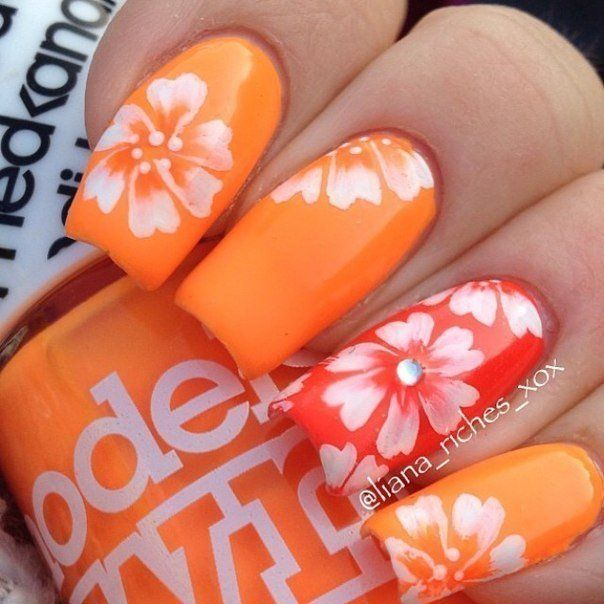This bright orange manicure will not let you to get bored. Ripe color and large design in the form of a flower supplemented as notable emphasis on the ring