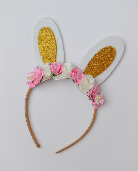 This listing is for one handmade bunny headband embellished with beautiful floral accents. Simple, yet beautiful! It is perfect for photos