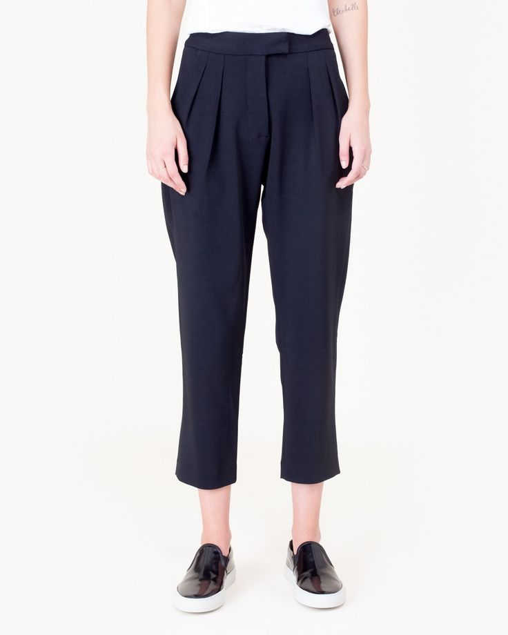 """Standard Pant in Black by Studio Nicholson. Trouser features a relaxed fit with tapered leg, front pleats, two side pockets, two rear welt pockets, belt loops, and a zipper button fly closure.  - 67% viscose, 31% acetate, 2% elastane  - 14.5"""" waist, 10"""" rise, 24"""" inseam  - Our model is approx. 5'8"""" and wearing a size 0 $395.00"""
