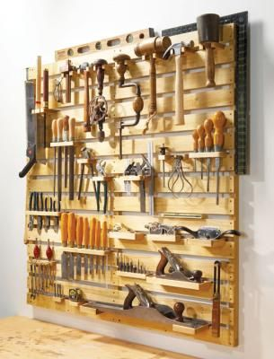Mother Earth News' free tutorial for building a slat based tool rack. This would be a beautiful way to organize all of my tools.
