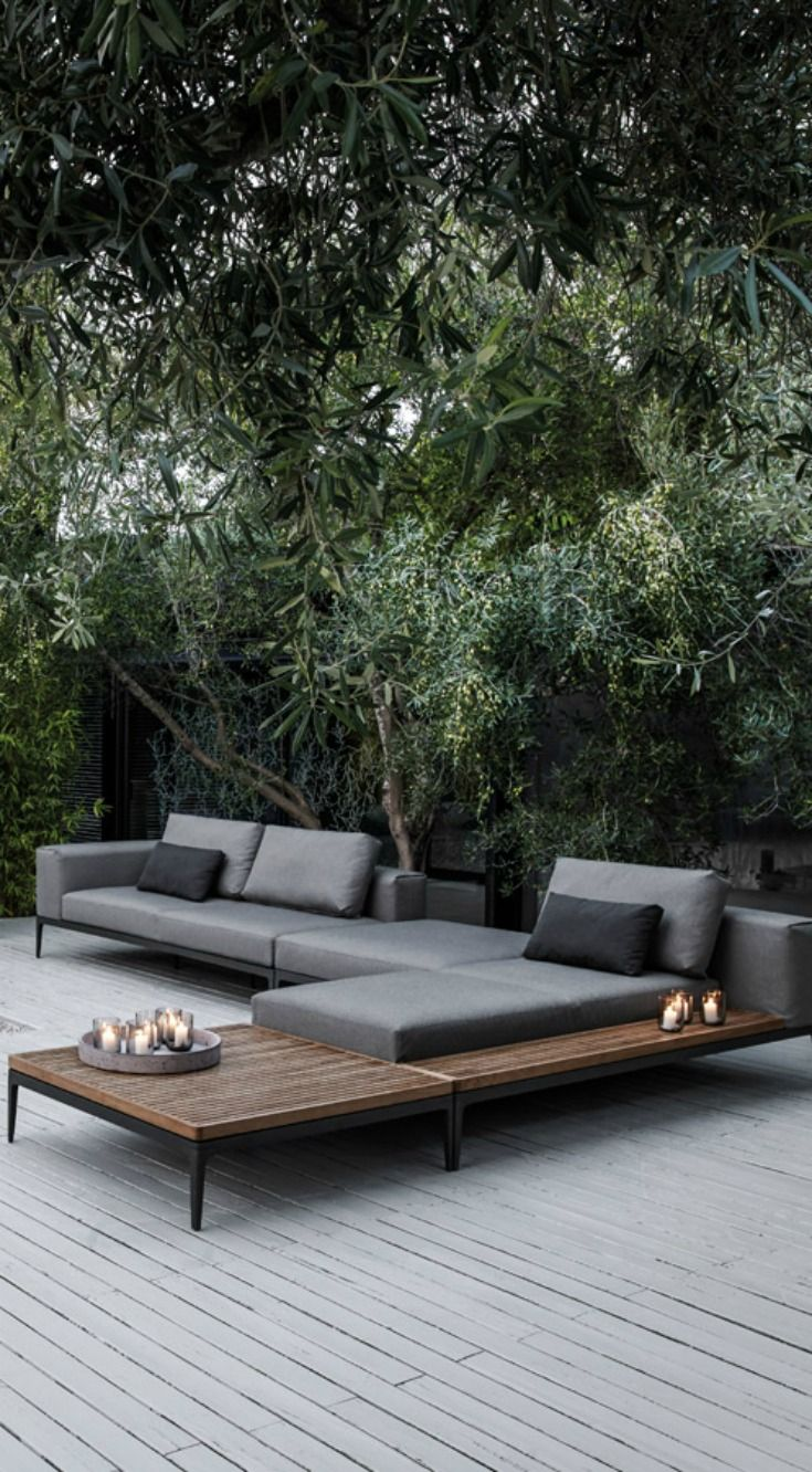 Gloster Grid | This award winning collection combines high quality materials to create multiple seating arrangements with these modular pieces.