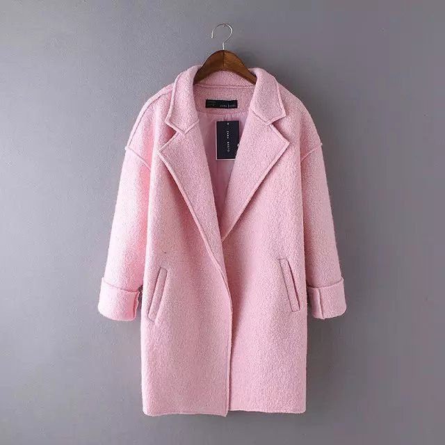 We love mixing styles as well as colors with styles. Here is a wool blend coat that features long lapels, dropped shoulders, and slash pockets. Tailored in boucle texture, this wool coat in pink color