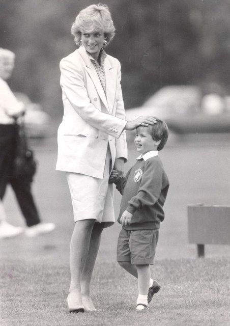 May 31, 1987: Princess Diana with Prince William at the Cartier polo tournament at Smith's Lawn, Windsor.