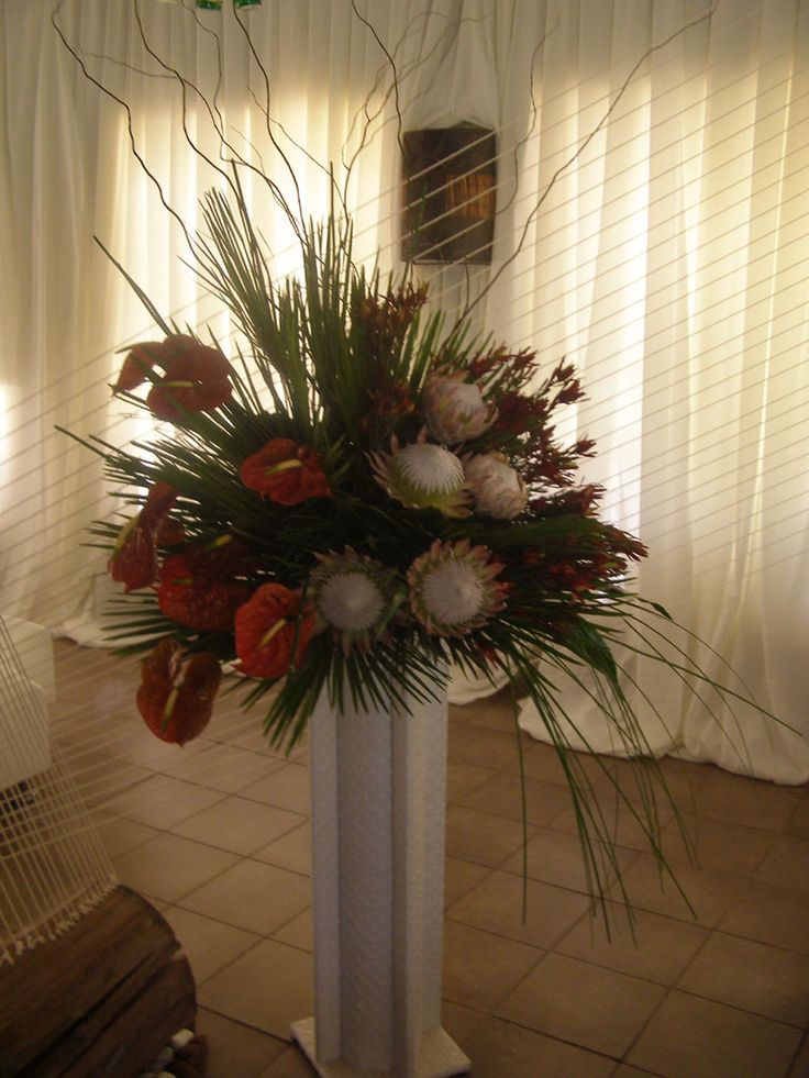 The string room divide was beautifully highlighted by this mass arrangement using the King Protea www.iceevents.co.za