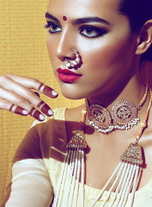 Gorgeous Indian jewellery. Statement nose ring, choker necklace. Red lips. Bronzer. Eye makeup.