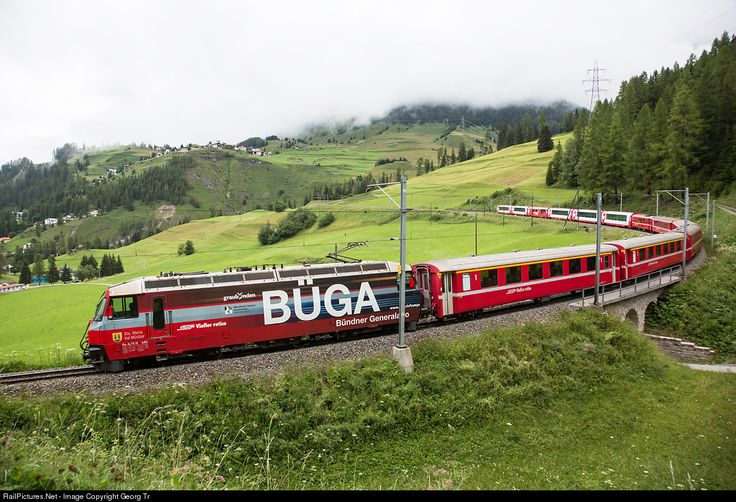 """Ge 4/4 III # 646 with publicity paint scheme for the Grisons general abonnement """"Büga"""" is pulling RE 1132 from St.Moritz over the Albula line to Chur above Bergün, with Latsch village on a nice offset."""
