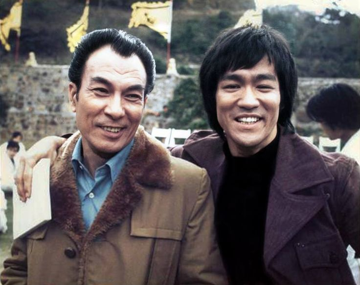 "On the set of ""Enter the Dragon""  Bruce Lee and Shek Wing-cheung (1 January 1913 – 3 June 2009), better known by his stage name Shih Kien (Cantonese: Shek Kin; Mandarin: Shi Jian) who play Mr Han."