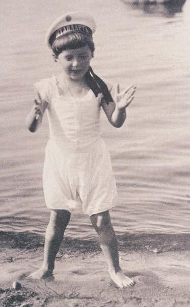 Tsarevich Alexei Nikolaevich Romanov playing in the sand on a beach.